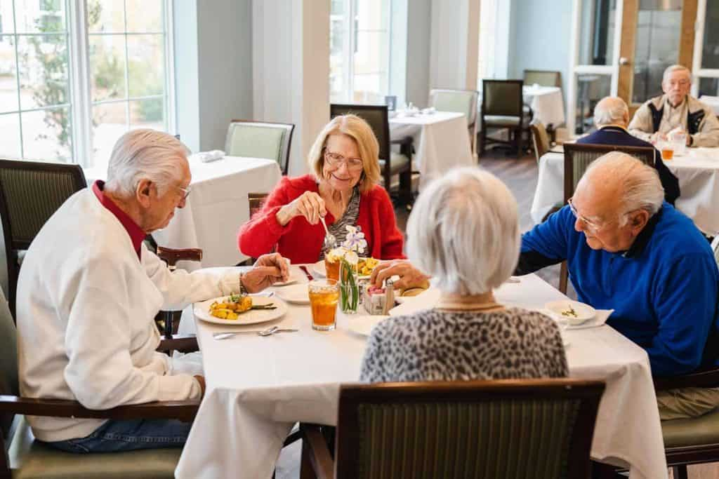 Seniors enjoying lunch in dining room